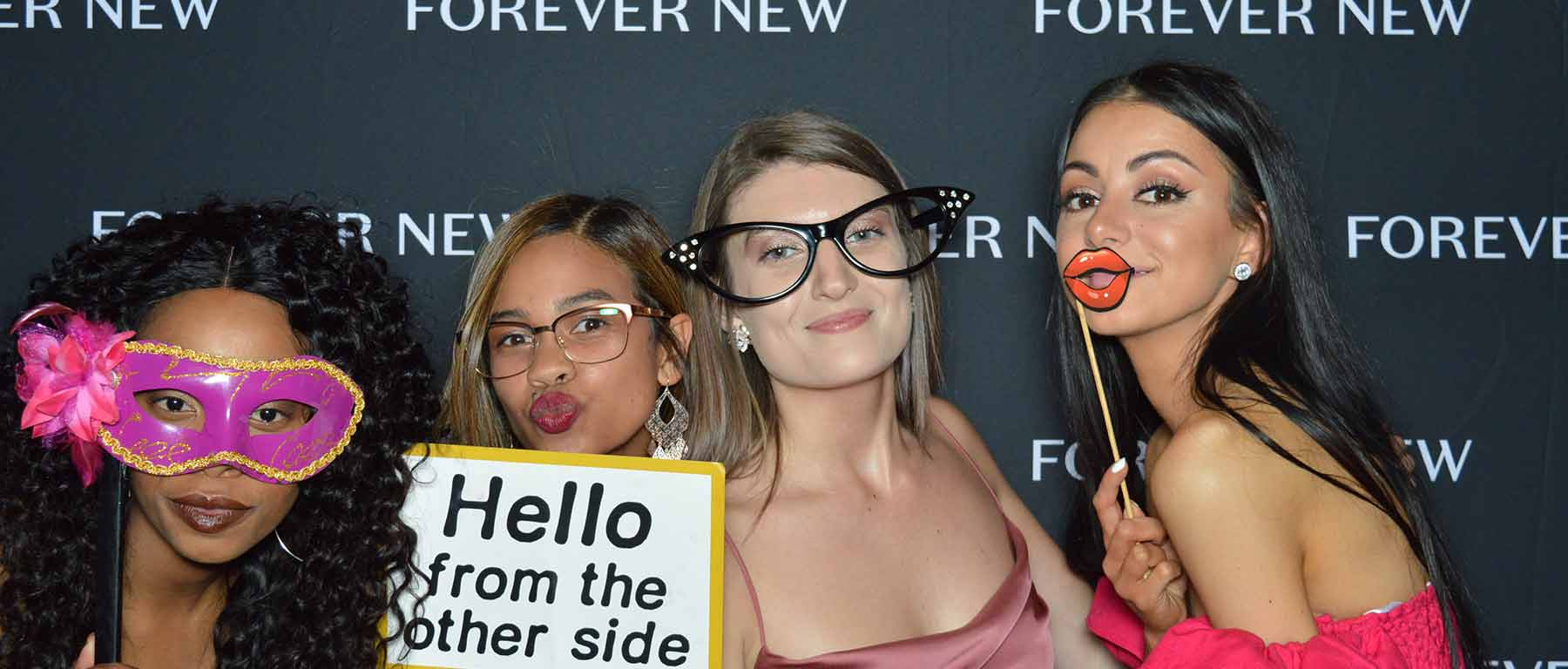 ladies posing with photo booth props